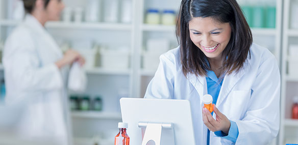 pharmacist-using-tablet-584x285